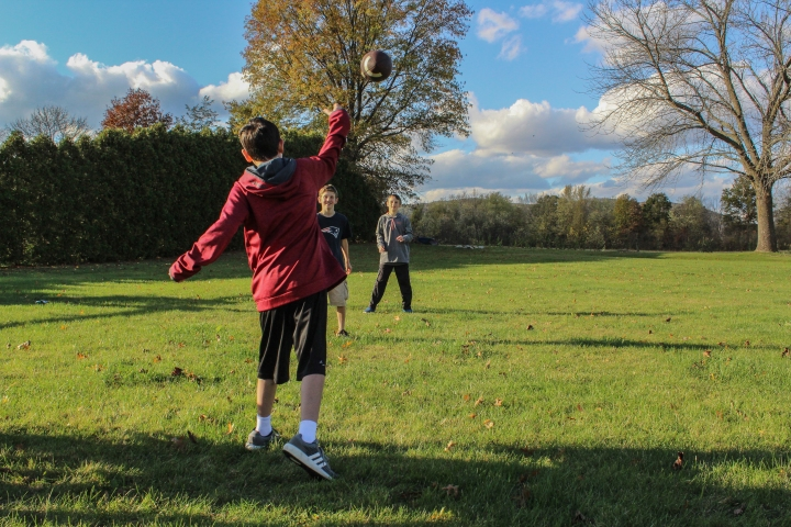 Luke throwing to brothers (1).jpg