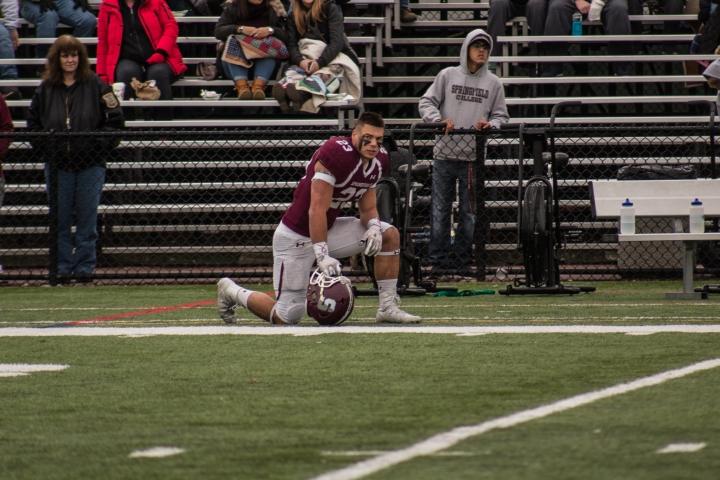 Wilcox kneeling